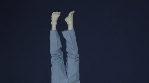 A dancers feet in the air while upside down